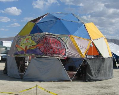 The Karma Chickens main dome with banner & Karma Chickens at Burning Man